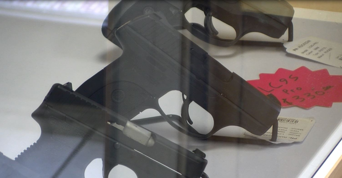 Handguns in a display case.