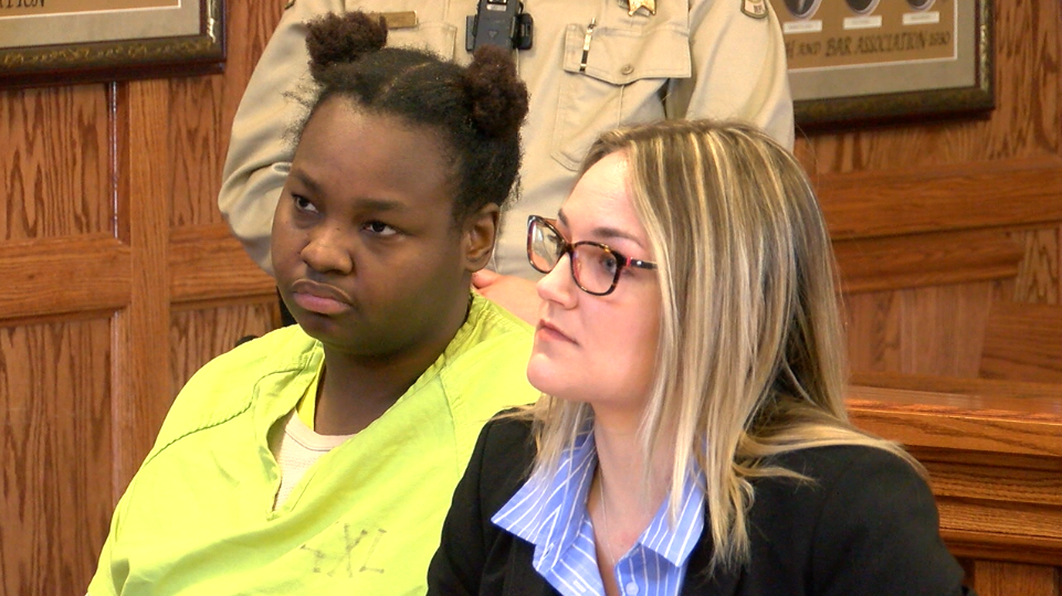 Quatavia Givens appears with her public defender during a hearing at the Cole County Courthouse.
