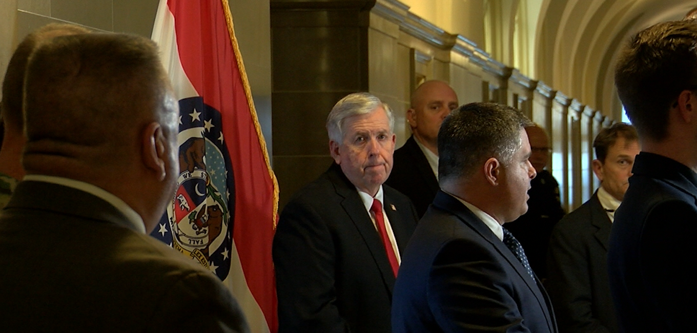 Gov. Mike Parson, facing camera, stands next to department directors at his daily COVID-19 briefing on Wednesday, March 18, 2020.