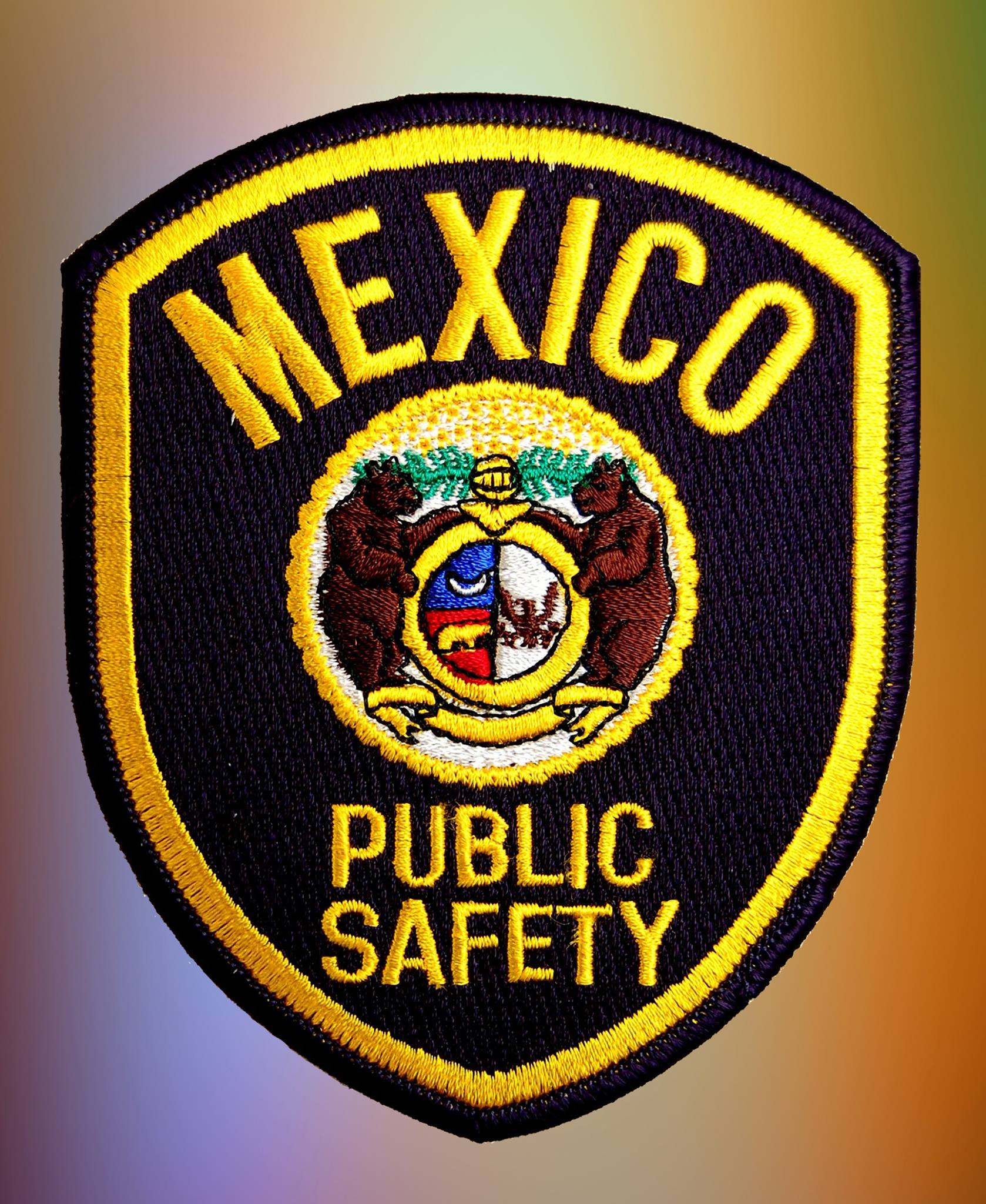 Mexico Public Safety Department badge.