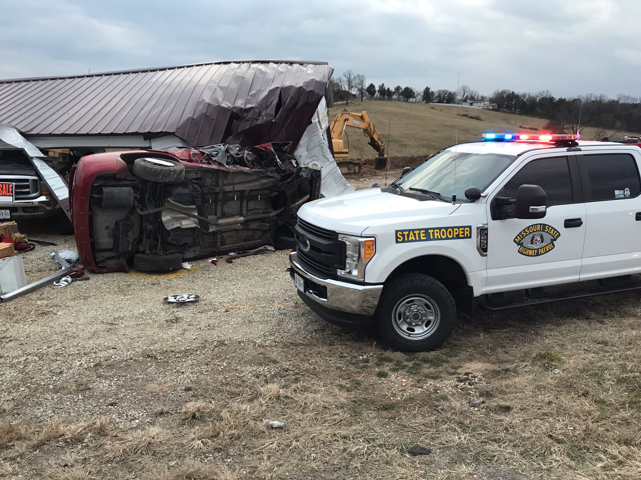 One killed after car hit building in Osage County