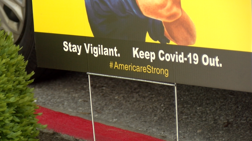 """A sign outside of The Neighborhoods by TigerPlace reading """"stay vigilant, keep COVID-19 out."""""""