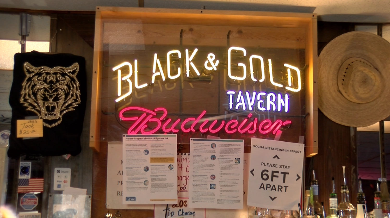 Black & Gold Tavern posted signs reminding customers to social distance.