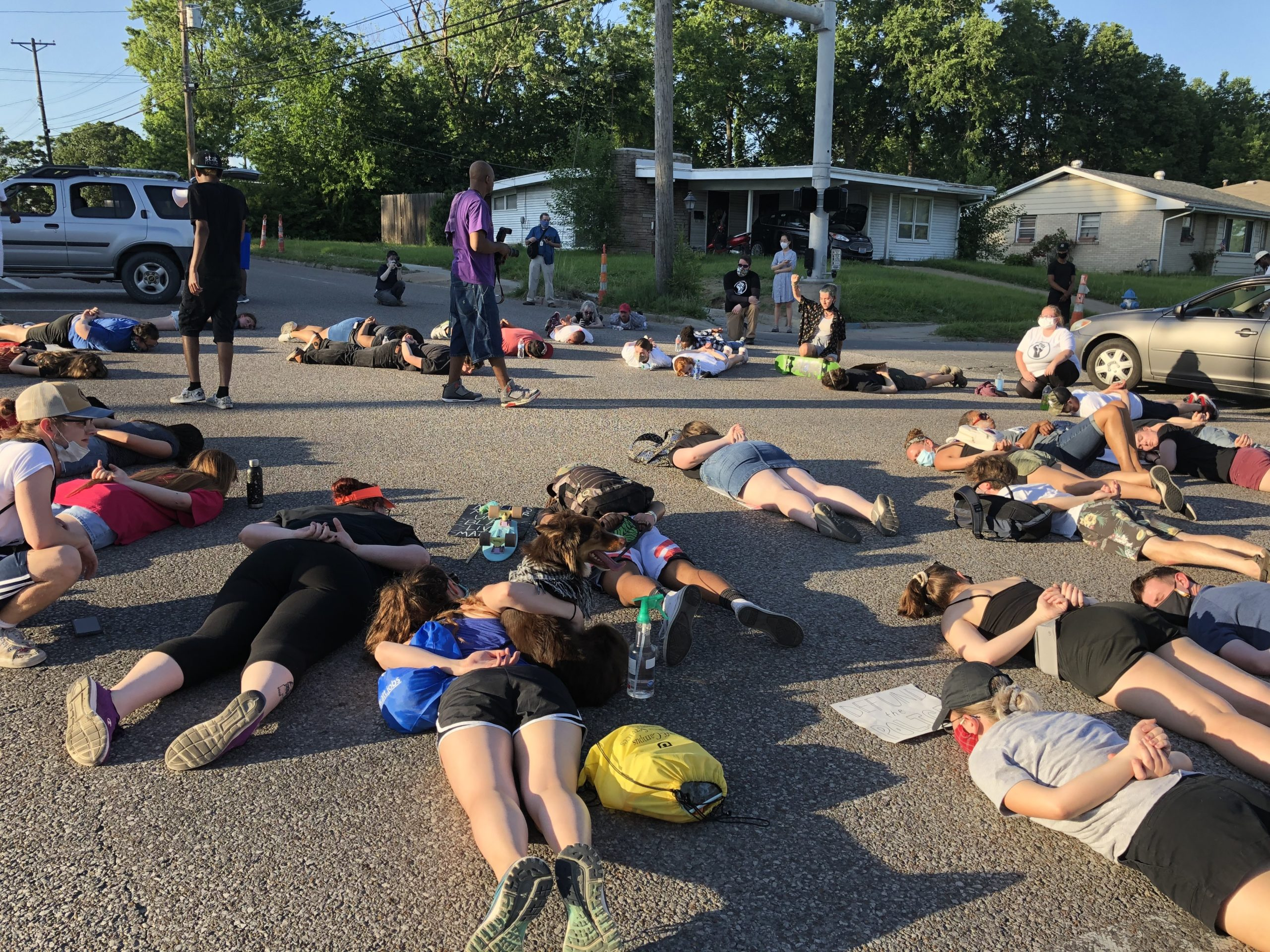 Protesters lay in an intersection on Providence Road.