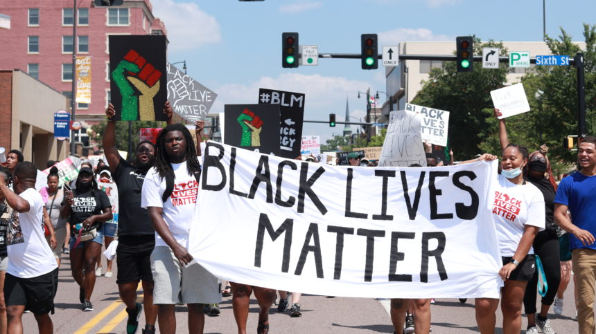 Protesters with Black Lives Matter banner