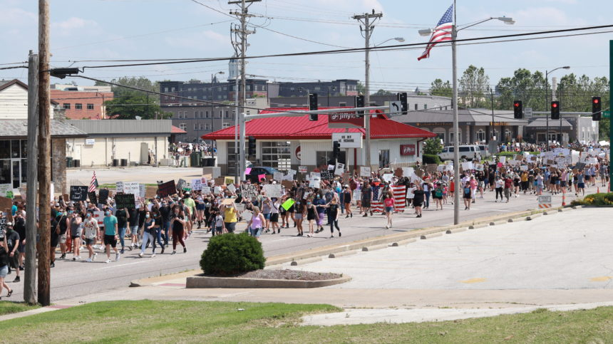 Protesters march on Providence Road