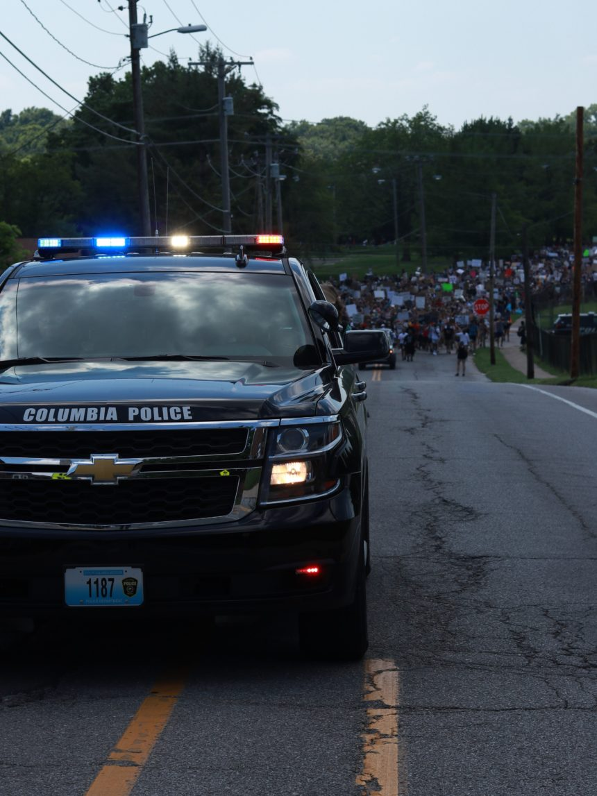 Police cruiser leads protesters