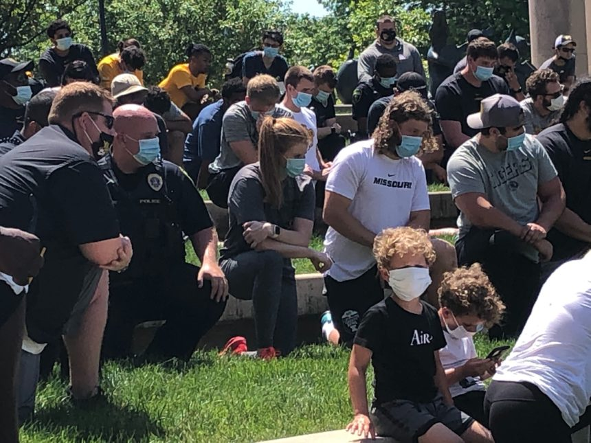 Columbia protesters take a knee