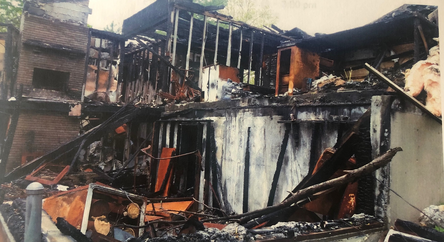 Burned out home on Alamos Place