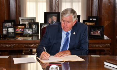 Gov. Mike Parson signs the fiscal 2021 budget