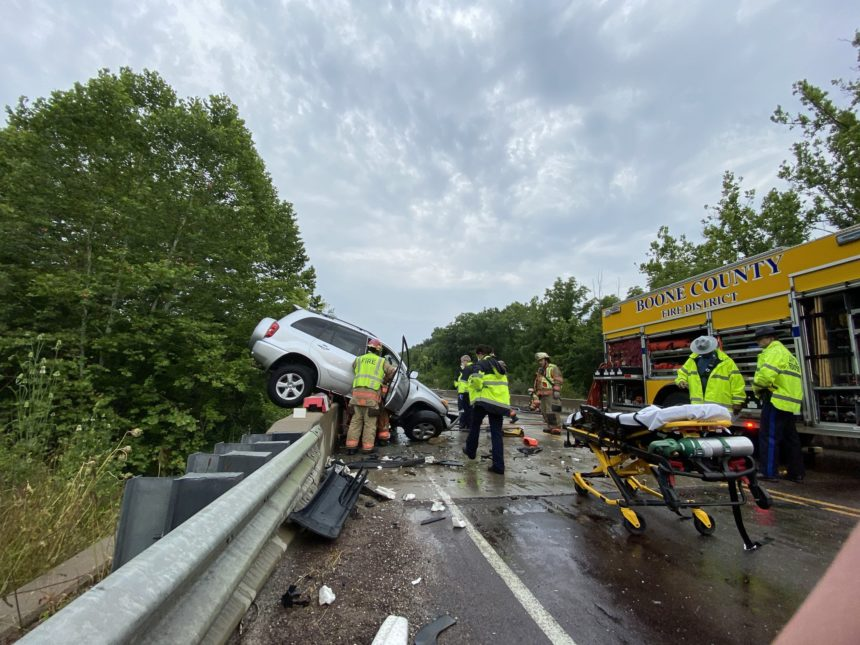 SUV hangs over bridge after Route WW crash