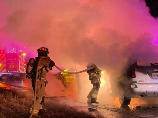 Car fire after crash into police cruiser