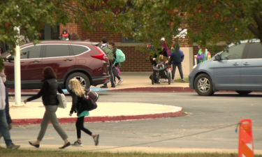 Parents drop off students as they return to in-person classes at Paxton Keeley Elementary.