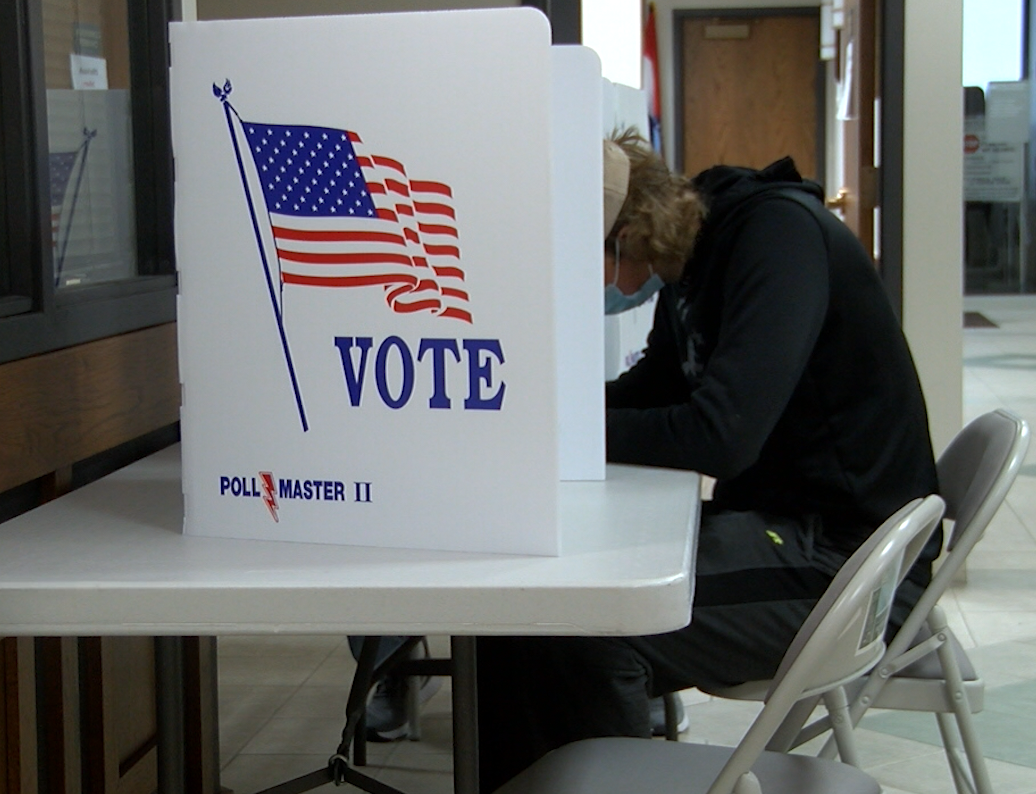A voter fills out a ballot at a Boone County polling place.
