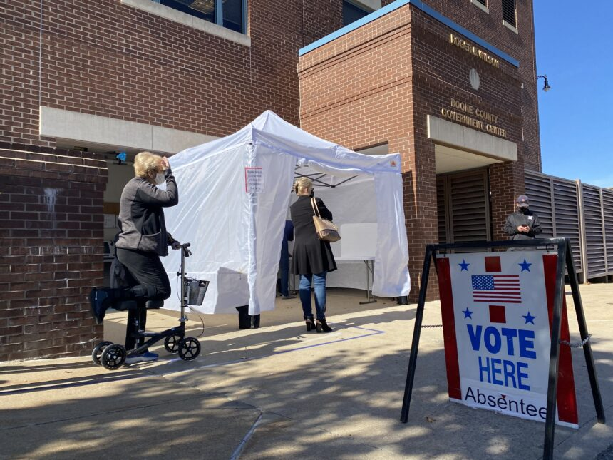Voters in line to cast their absentee ballots Monday at the Boone County Government Center.