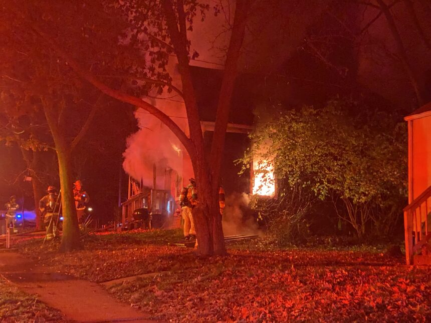 Fire crews work to put out a house fire on McBaine Avenue in Columbia.
