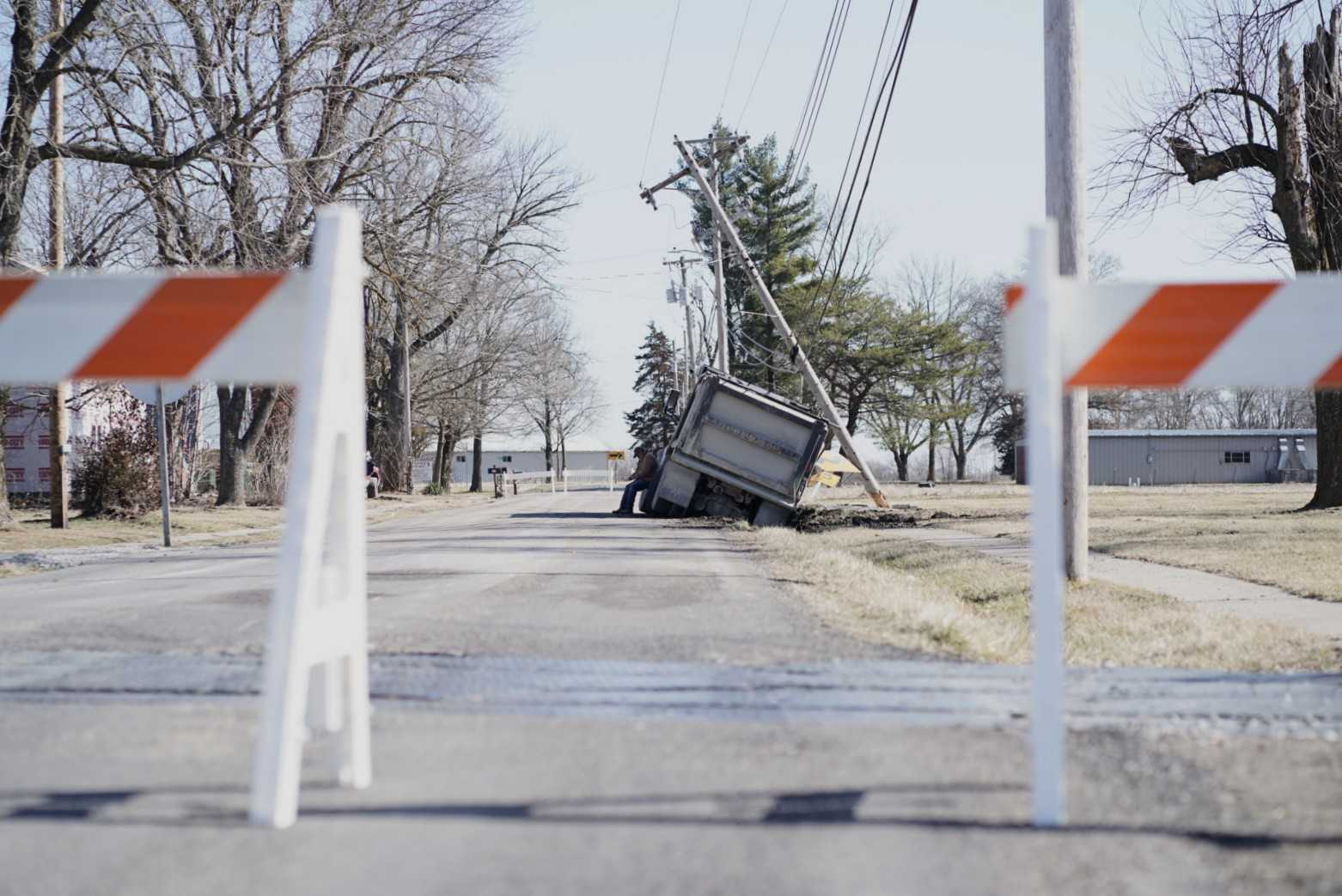 Crews closed a portion of E. Highway OO Tuesday afternoon after a dump truck crashed into an electric pole.