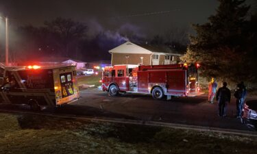 Smoke comes from an apartment building on Quail Drive.