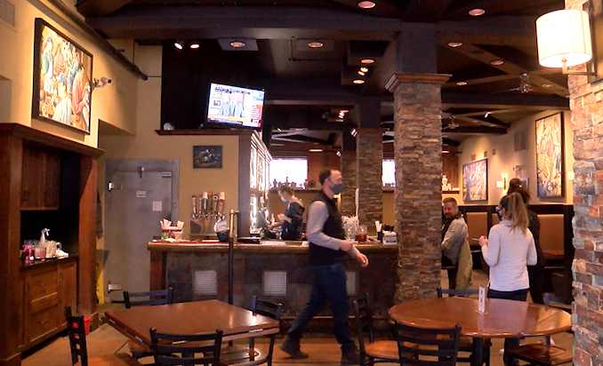 Employees gather in Addison's in downtown Columbia during Restaurant Week