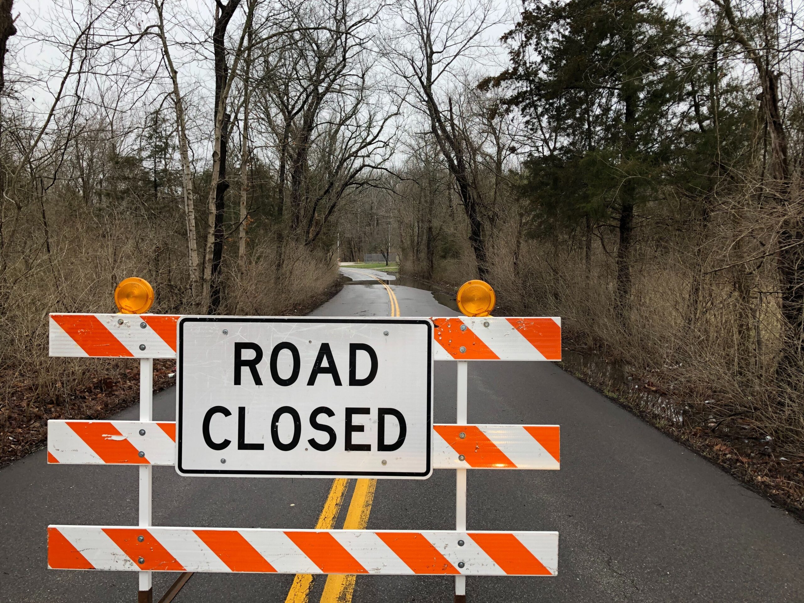 A barrier sits on Old Plank Road amid flooding on Wednesday, March 17, 2021.