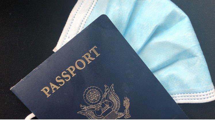 U.S. passport and mask