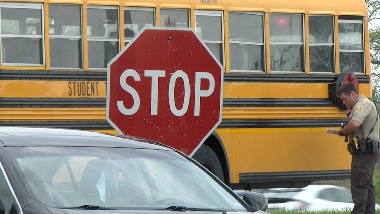 A CPS school bus near a stop sign.