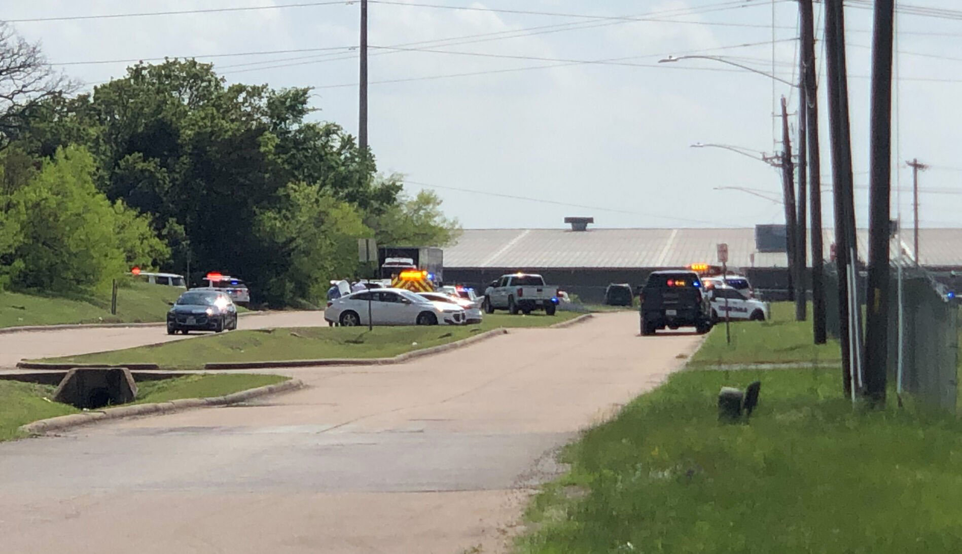 Law enforcement responds to a reported shooting at Kent Moore Cabinets in Bryan, Texas, on April 8, 2021.