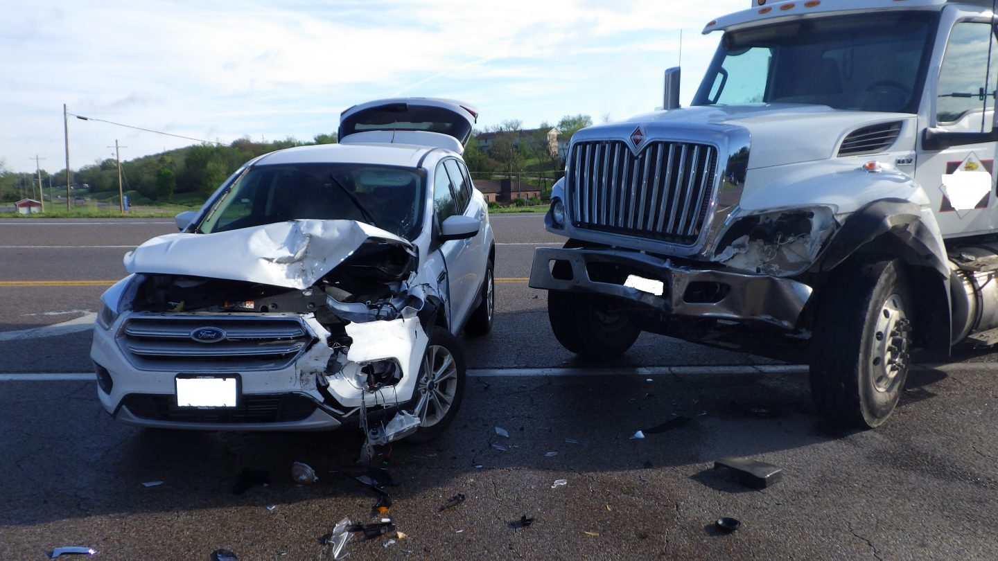 A Ford Escape and dump truck were damaged in a four-vehicle crash in Jefferson City on Monday, May 3, 2021.