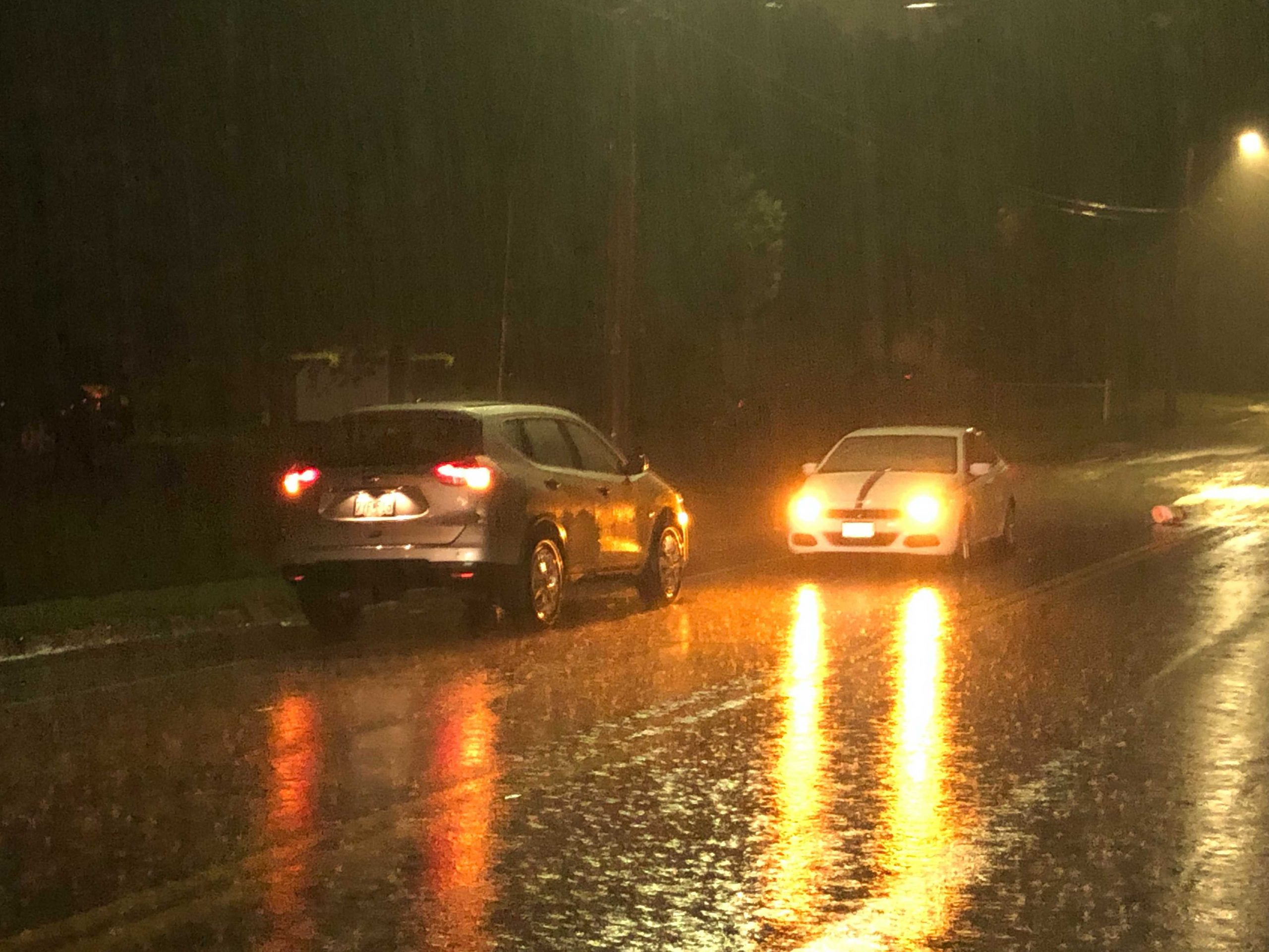 Vehicles stopped in heavy rains in Columbia.