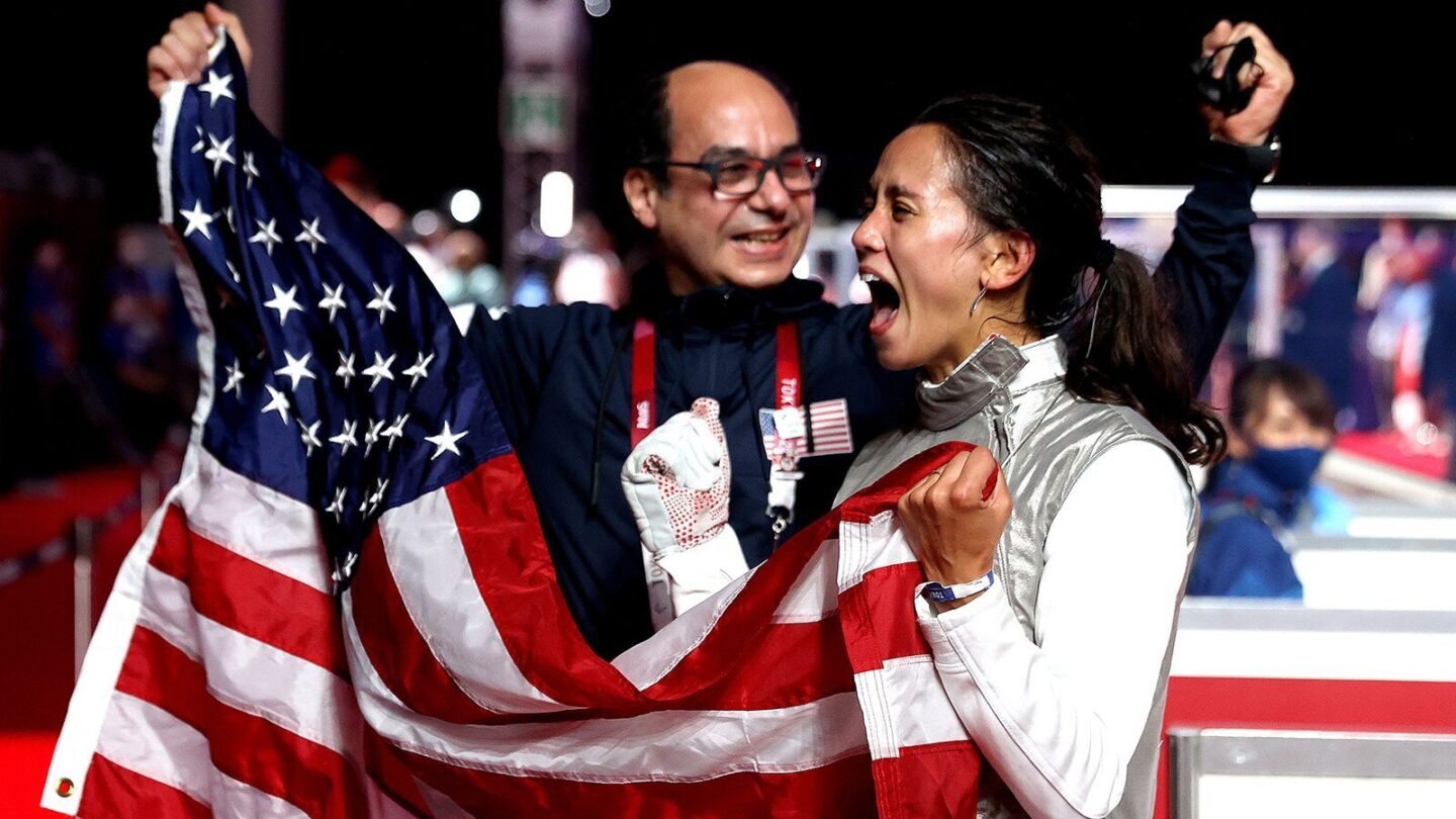 <i>Elsa/Getty Images</i><br/>Lee Kiefer of the United States celebrates with her coach after winning gold in fencing against Inna Deriglazova of the Russia Olympic Committee on July 25.
