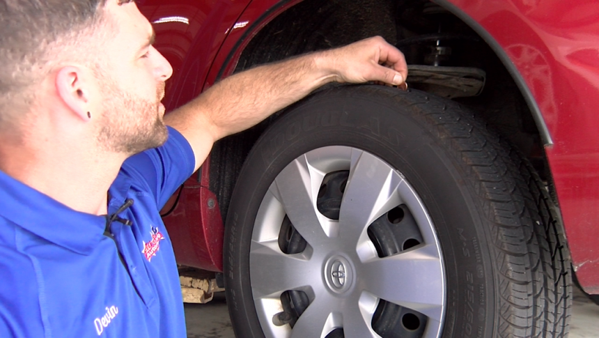 Devin Kelley, Owner of All Star Automotive demonstrates how to check tire pressure, July 1