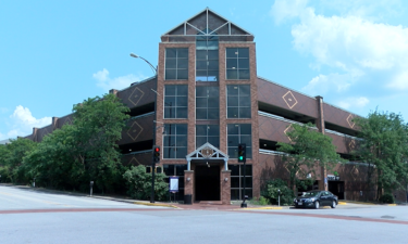 Columbia City Council pushes back vote on Tenth and Cherry Streets parking garage hotel spaces.