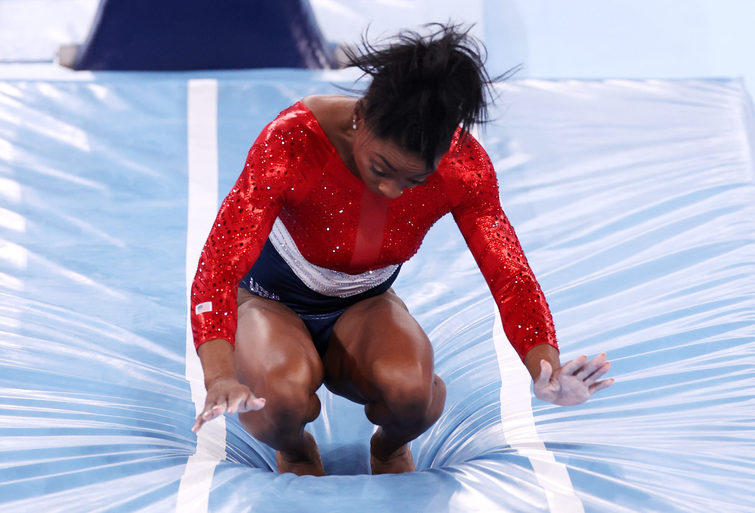 <i>Jamie Squire/Getty Images</i><br/>Simone Biles of Team United States stumbles upon landing after competing in vault during the women's team final on day four of the Tokyo 2020 Olympic Games at Ariake Gymnastics Centre.