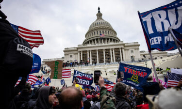Pro-Trump supporters storm the U.S. Capitol following a rally with President Donald Trump on January 6. The Justice Department formally declined to assert executive privilege for potential testimony of at least some witnesses related to the January 6 Capitol attack.