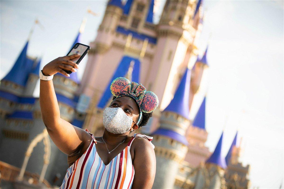 <i>Walt Disney World Resort/Getty Images</i><br/>A guest stops to take a selfie at Magic Kingdom Park at Walt Disney World Resort on July 11