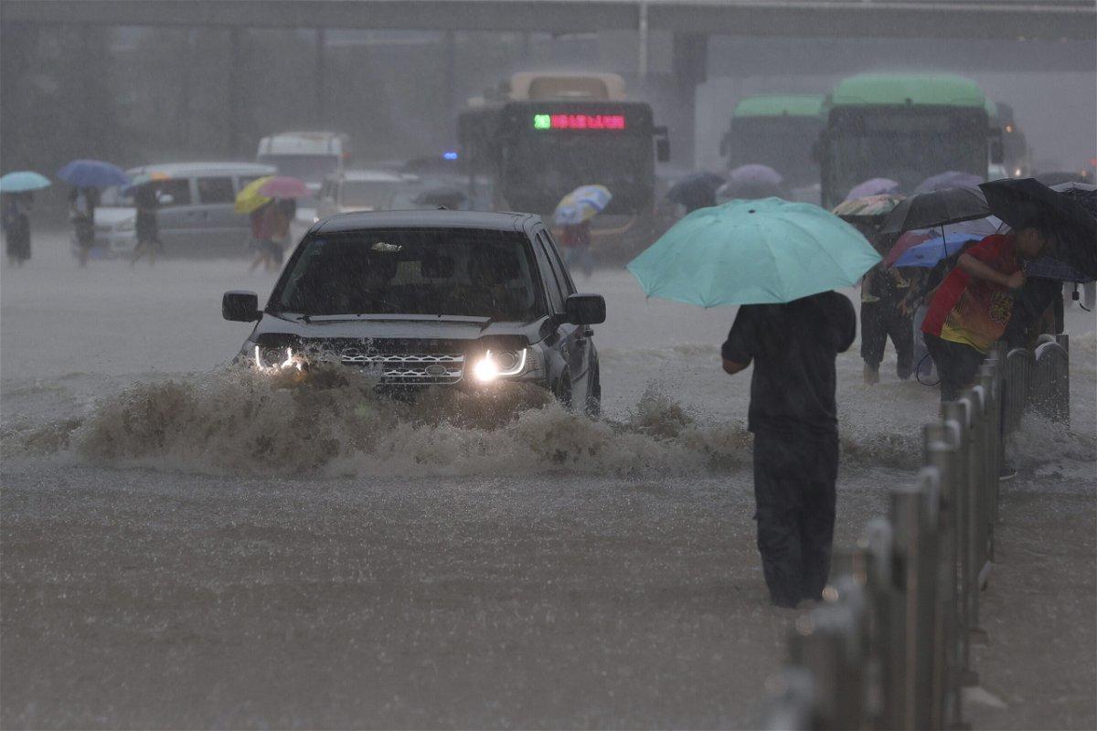 <i>yuanxiaoqiang/Chinatopix/AP</i><br/>A heavy downpour is shown in Zhengzhou