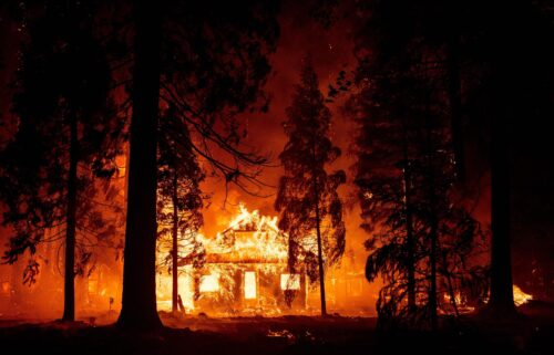 A home burns as flames from the Dixie fire tear through the Indian Falls neighborhood on July 24.
