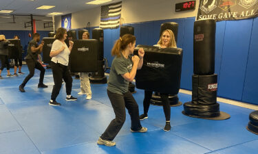 Flight attendants train at a gym in Florida.