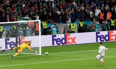 Italy's goalkeeper Gianluigi Donnarumma stops a penalty shot from Spain's Alvaro Morata during the semifinal match between Italy and Spain in London