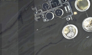 This image provided by NOAA taken on August 31 and reviewed by The Associated Press shows oil slicks at the flooded Phillips 66 Alliance Refinery in Belle Chasse