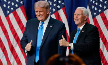 Former President Donald Trump and former Vice President Mike Pence give a thumbs up after speaking on the first day of the Republican National Convention at the Charlotte Convention Center on August 24