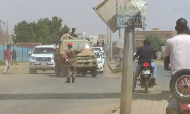 Sudanese soldiers block the road for taking precautions after a failed coup attempt in Khartoum