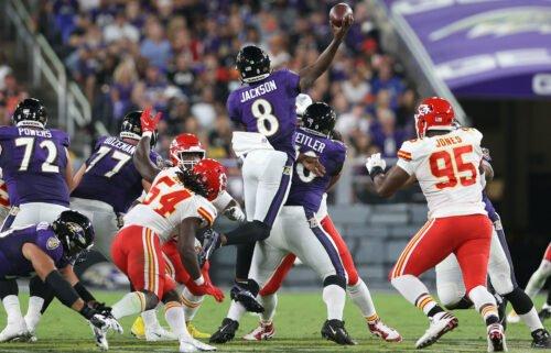Jackson throws a touchdown while in midair against the Chiefs.