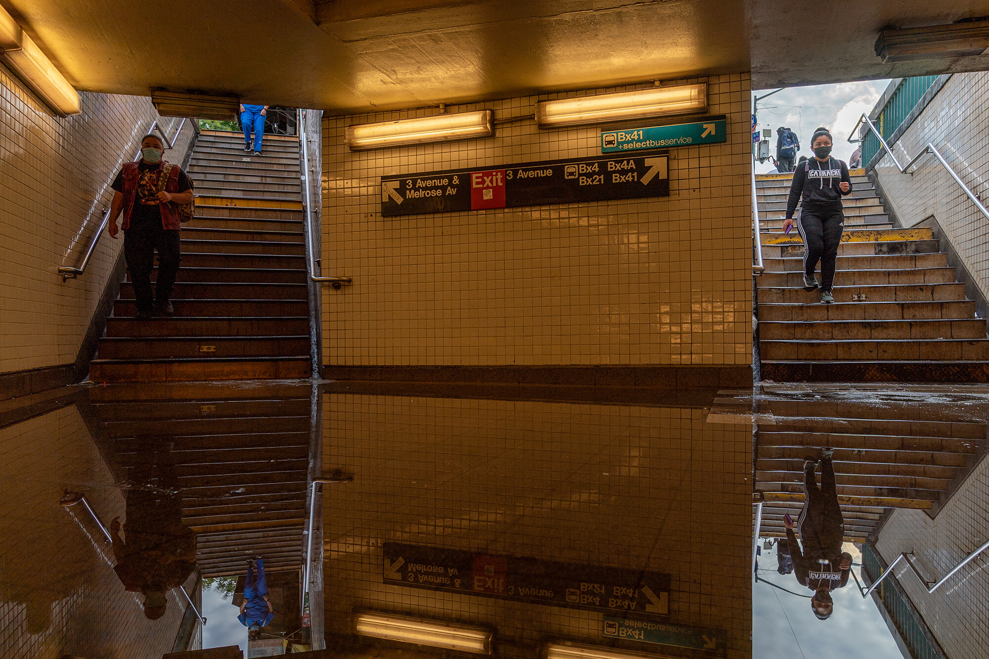 <i>David Dee Delgado/Getty Images</i><br/>Commuters walk into a flooded 3rd Avenue / 149th st subway station and disrupted service due to extremely heavy rainfall from the remnants of Hurricane Ida on September 2
