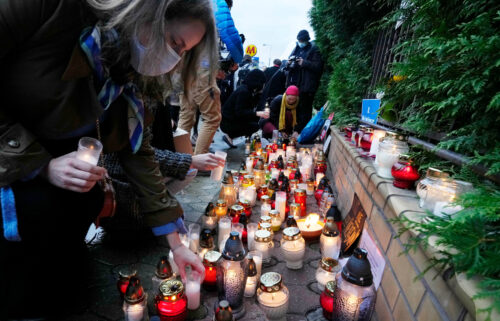 Warsaw residents light candles at the national border guard headquarters