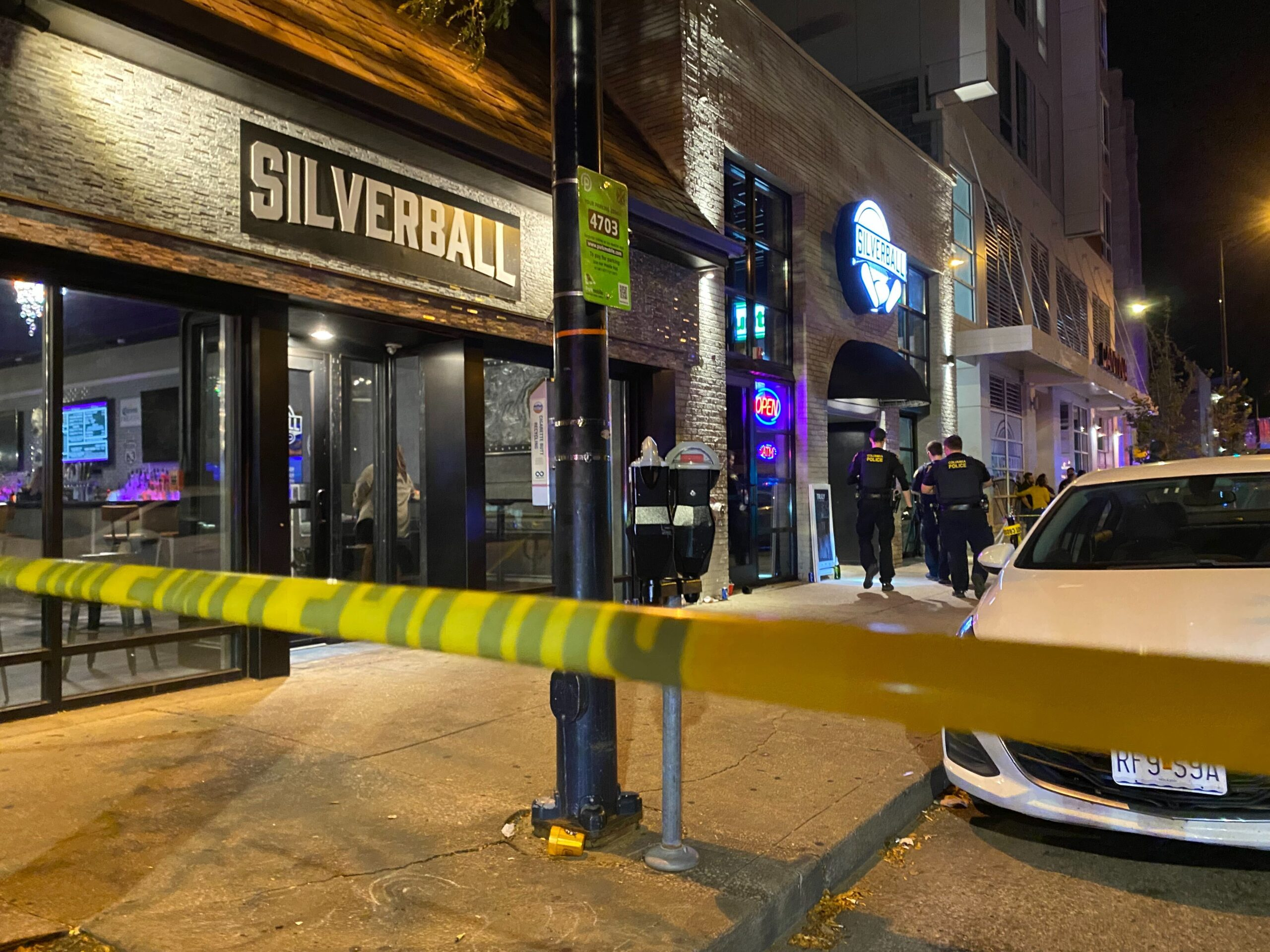 Columbia Police officers investigate the scene of an overnight shooting near the corner of Ninth and Locust Streets in downtown Columbia early Sunday, Oct. .10, 2021.