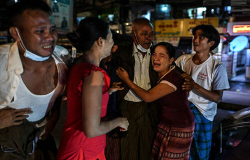 A man is reunited with his family members following his release outside Insein Prison in Yangon