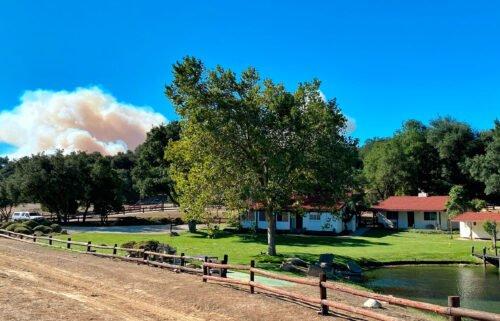 A smoke column builds in the distance behind Rancho del Cielo in Santa Barbara County.