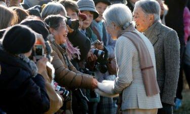 Fumiko Shirataki shakes hands with Japan's then-Empress Michiko in January 2019.